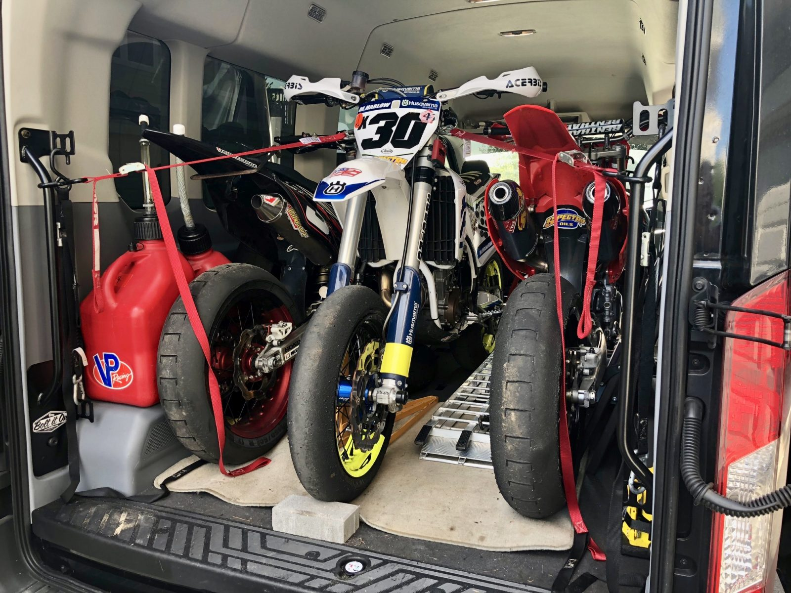 3 Motorcycles Loaded In Ford Transit Passenger